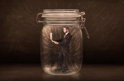 El hombre de negocios dentro de un tarro con la mano potente dibujada alinea concepto Fotos de archivo libres de regalías