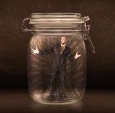 El hombre de negocios dentro de un tarro con la mano potente dibujada alinea concepto Fotografía de archivo libre de regalías