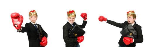 El hombre de negocios divertido con los guantes de la corona y de boxeo fotografía de archivo libre de regalías