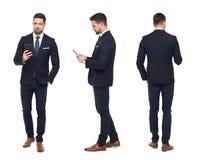 El hombre de negocios elegante joven usando frente de la tableta, lado, vista posterior es Fotografía de archivo