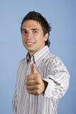 El hombre de negocios emocionado da el pulgar para arriba Fotos de archivo