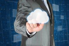El hombre de negocios empuja la nube fotografía de archivo libre de regalías