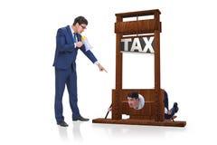El hombre de negocios en concepto pesado del negocio de los altos impuestos foto de archivo libre de regalías
