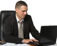 El hombre de negocios en el lugar de trabajo Fotografía de archivo libre de regalías