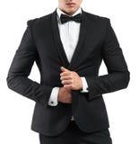 El hombre de negocios en un traje endereza chaqueta Fotos de archivo