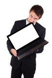 El hombre de negocios encolerizado muerde la computadora portátil imagen de archivo