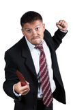 El hombre de negocios enojado amenaza con un cuchillo Foto de archivo libre de regalías