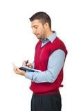El hombre de negocios escribe en su agenda Imágenes de archivo libres de regalías