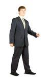 El hombre de negocios está recorriendo Foto de archivo libre de regalías