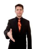 El hombre de negocios está sacudiendo su mano Imagen de archivo libre de regalías