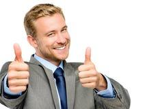 El hombre de negocios feliz manosea con los dedos encima de muestra en el fondo blanco Imágenes de archivo libres de regalías