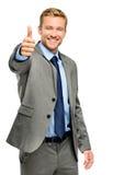 El hombre de negocios feliz manosea con los dedos encima de muestra en el fondo blanco Fotografía de archivo libre de regalías