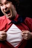 El hombre de negocios furioso rasga su camisa Foto de archivo