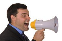 El hombre de negocios grita en megáfono Fotos de archivo libres de regalías