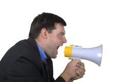 El hombre de negocios grita en megáfono Imagen de archivo