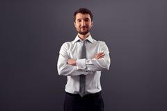 Hombre de negocios hermoso con las manos dobladas Imagen de archivo libre de regalías