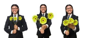 El hombre de negocios hermoso con la flor aislada en blanco fotografía de archivo