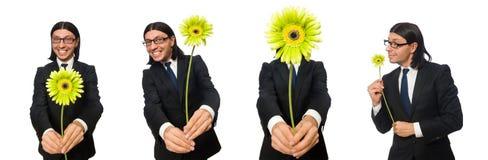 El hombre de negocios hermoso con la flor aislada en blanco imágenes de archivo libres de regalías