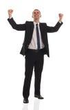El hombre de negocios hermoso emocionado con los brazos levantó adentro Imagen de archivo libre de regalías