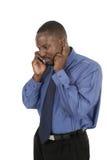 El hombre de negocios hermoso toma una llamada de la célula Imágenes de archivo libres de regalías