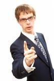 El hombre de negocios joven amenaza al dedo de la pizca Imagen de archivo libre de regalías