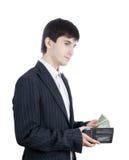 El hombre de negocios joven con el dinero (aislado) Fotos de archivo