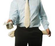 El hombre de negocios joven con los bolsillos vacíos Imagenes de archivo