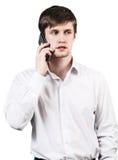 El hombre de negocios joven habla en el teléfono Imagenes de archivo