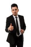 El hombre de negocios joven hermoso que muestra los pulgares sube la muestra Fotografía de archivo libre de regalías