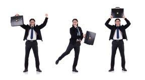 El hombre de negocios joven que sostiene la cartera aislada en blanco imagen de archivo
