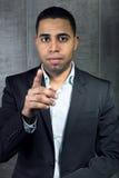 El hombre de negocios joven señala su finger en usted Fotografía de archivo