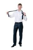 El hombre de negocios joven sujeta un lazo Imagen de archivo