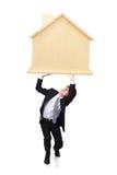 El hombre de negocios joven tiene préstamo hipotecario pesado Imágenes de archivo libres de regalías