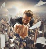 El hombre de negocios le gusta un super héroe Imagen de archivo