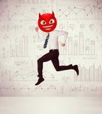 El hombre de negocios lleva la cara del smiley del diablo Foto de archivo