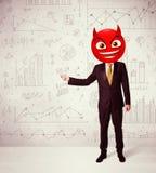 El hombre de negocios lleva la cara del smiley del diablo Imagen de archivo