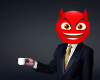 El hombre de negocios lleva la cara del smiley del diablo Imagen de archivo libre de regalías