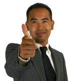 El hombre de negocios manosea con los dedos para arriba Foto de archivo