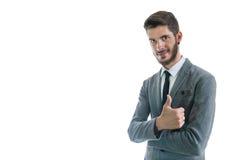 El hombre de negocios manosea con los dedos para arriba Imagen de archivo