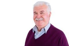 El hombre de negocios mayor en suéter sonríe en la cámara Foto de archivo libre de regalías
