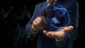 El hombre de negocios muestra a holograma 3d del concepto el ordenador portátil viejo en su mano almacen de metraje de vídeo