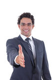 El hombre de negocios ofrece su mano Foto de archivo libre de regalías