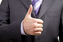 El hombre de negocios ofrece Thumbs-Up Fotografía de archivo libre de regalías