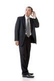El hombre de negocios oye foto de archivo