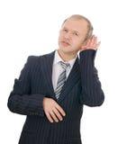 El hombre de negocios que escucha aislado Fotos de archivo