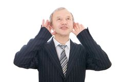 El hombre de negocios que escucha aislado Imagen de archivo