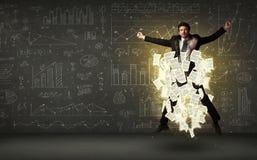 El hombre de negocios que salta con la nube del documento de papel Imagen de archivo