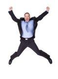 El hombre de negocios que salta en alegría Fotografía de archivo libre de regalías