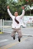 El hombre de negocios que salta para la alegría Imagen de archivo