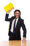 El hombre de negocios que sostiene los cuadernos aislados en blanco Foto de archivo